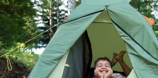 boy in camping tent
